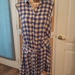 Knee length sleeveless button front dress